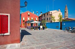 Picture Caorle with its colourful houses, restaurants and cafes attracts holiday makers.